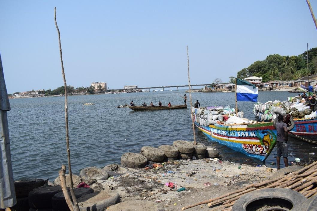 Boat transporting goods to Freetown through Cockle Bay and fish processing
