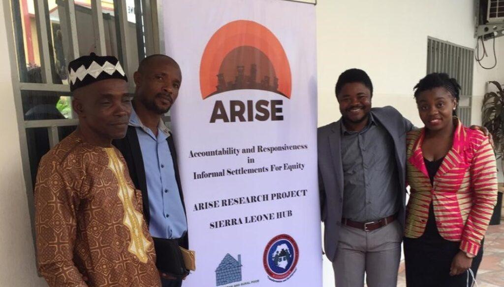 Sierra Leone team and a community elder at their launch