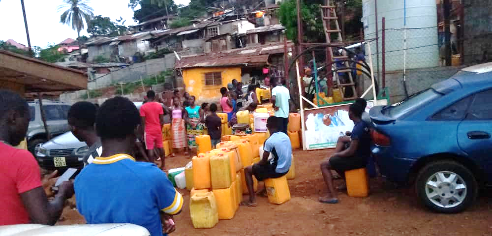 Residents of Dwarzark queuing up for water during lockdown