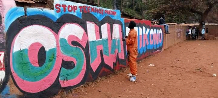 A colourful mural advocating for an end to teenage pregnancy