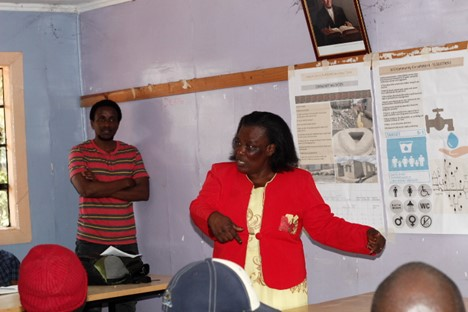 Anastacia Wairimu leading community discussions in Mukuru