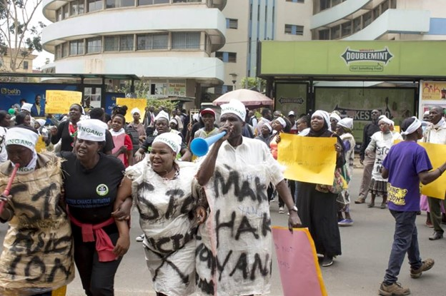 Emily (pictured second from the left) participating in peaceful demonstrations in Nairobi, calling an end to forceful evictions