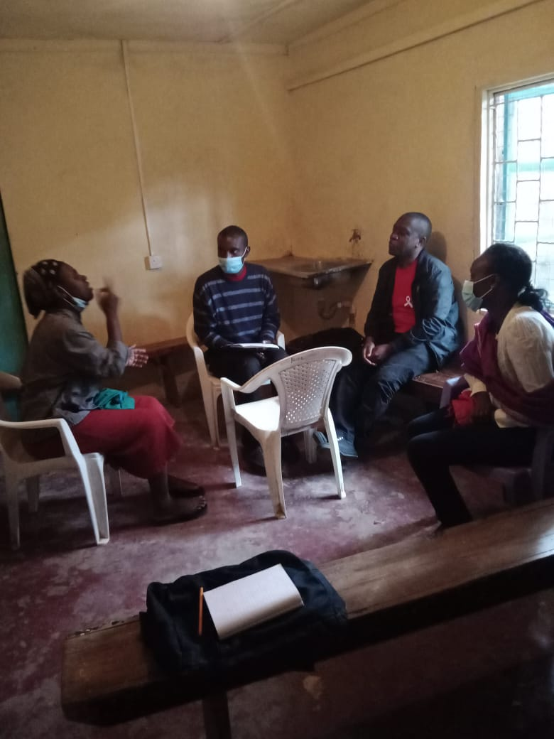 Nelly conducting an interview session with Miriam who is deaf with Eddie doing the sign language translation